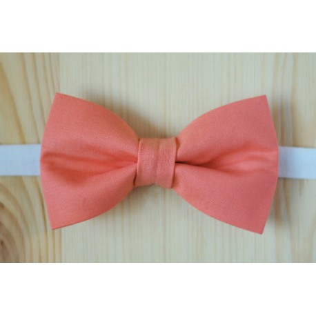 Pink pre-tied bow tie with white strap